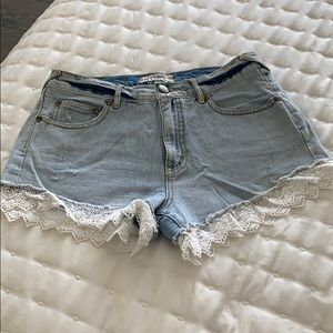 Free People lace trimmed blue jean shorts